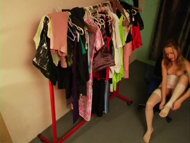 Half bare doll on fitting room spy cam
